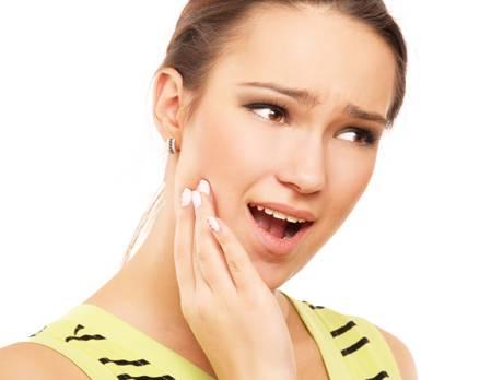 Làm gì với cơn đau mọc răng khôn